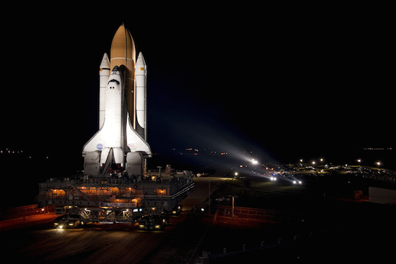 Atlantis Space Shuttle illuminated on on the launch pad awaiting countdown