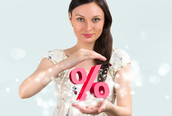 Image of woman holding a percentage sign