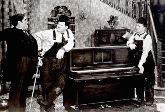 Screenshot from Laurel & Hardy to show how influencing amazon's algorithms is like moving a piano